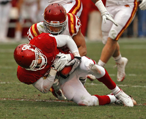 Oklahoma's Kenny Stills (4) secures the  ball after a catch in front of Iowa State's Ter'Ran Benton (22) during a college football game between the University of Oklahoma Sooners (OU) and the Iowa State University Cyclones (ISU) at Gaylord Family-Oklahoma Memorial Stadium in Norman, Okla., Saturday, Nov. 26, 2011. Photo by Steve Sinsey, The Oklahoman