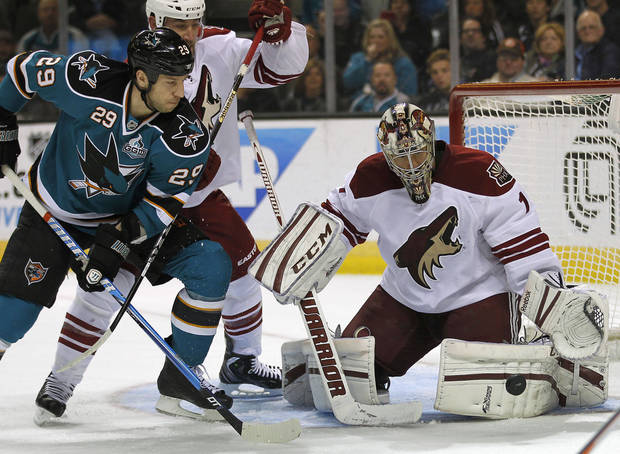 Phoenix Coyotes goalie Jason LaBarbera (1), blocks a goal attempt San Jose Sharks right wing Ryane Clowe (29) during the first period of an NHL hockey game in San Jose, Calif., Saturday, March 30, 2013. (AP Photo/Tony Avelar)