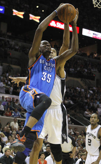 Oklahoma City's Kevin Durant (35) goes to the basket in front of San Antonio's Tim Duncan (21) during Game 2 of the Western Conference Finals between the Oklahoma City Thunder and the San Antonio Spurs in the NBA playoffs at the AT&T Center in San Antonio, Texas, Tuesday, May 29, 2012. Photo by Bryan Terry, The Oklahoman