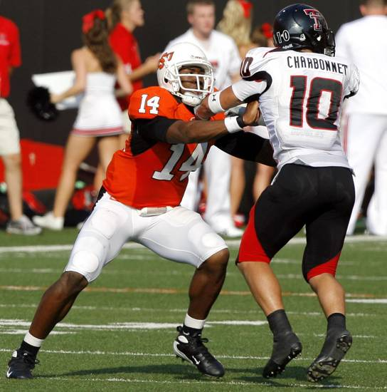 OSU&#039;s Bobby Reid (14) blocks Texas Tech&#039;s Daniel Chabonnet during the second half of the college football game between the Oklahoma State University Cowboys (OSU) and the Texas Tech University Red Raiders (TTU) at Boone Pickens Stadium  on Saturday, Sept. 22, 2007, in Stillwater, Okla. 