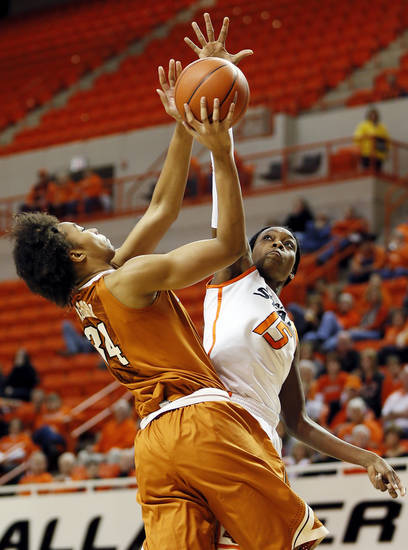 Oklahoma State's Toni Young (15) blocks the shot of Texas' Imani McGee-Stafford (34) during a women's college basketball game between Oklahoma State University (OSU) and the University of Texas at Gallagher-Iba Arena in Stillwater, Okla., Saturday, March 2, 2013. Photo by Nate Billings, The Oklahoman