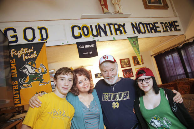 Notre Dame fans Cynthia and Tim Flenniken stand with their 16-year-old twins John and Hannah in their Edmond living room. Photo by Doug Hoke, The Oklahoman