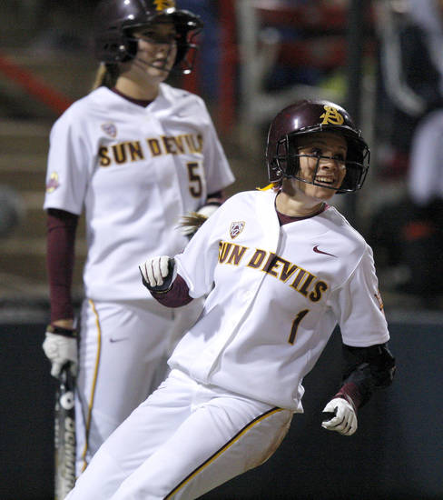 Arizona State's Kayla Ketchum smiles as she scores in the fourth inning during a Women's College World Series game against Alabama at ASA Hall of Fame Stadium in Oklahoma City, Friday, June 1, 2012.  Photo by Bryan Terry, The Oklahoman