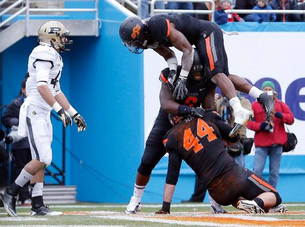 Oklahoma State celebrates a touchdown during the Heart of Dallas Bowl football game between Oklahoma State University (OSU) and Purdue University at the Cotton Bowl in Dallas,  Tuesday, Jan. 1, 2013. Photo by Sarah Phipps, The Oklahoman