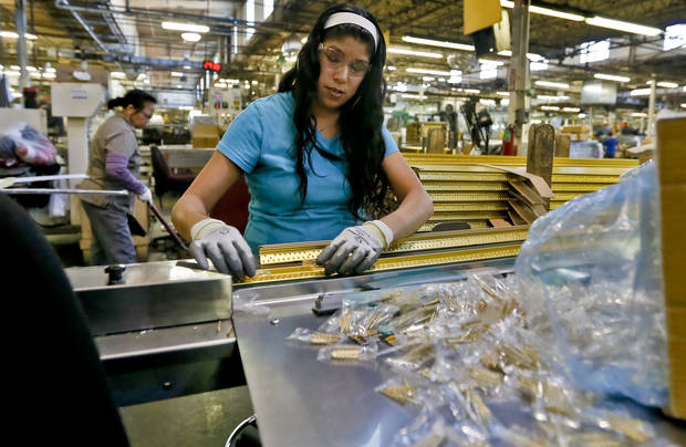 Corina Morales prepares products for packaging at the MD Building Products plant on Wednesday, Jan. 2, 2013, in Oklahoma City, Okla. Photo by Chris Landsberger, The Oklahoman
