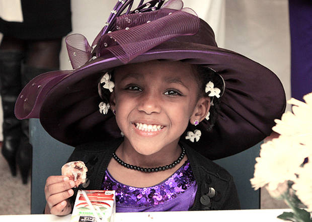 Brookelynne Wallace, 4, dressed in her best church hat, attends the ninth annual Crowns Tea Sunday at the Norman Public Library. PHOTO BY LYNETTE LOBBAN, FOR THE OKLAHOMAN