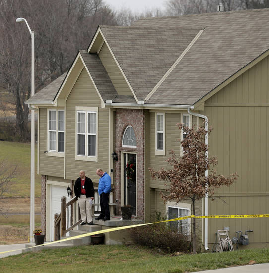 Investigators stand outside an Independence, Mo., house where police say Kansas City Chiefs linebacker Jovan Belcher fatally shot his girlfriend before driving to the NFL football team's training facility and shooting himself, Saturday, Dec. 1, 2012. (AP Photo/Charlie Riedel)
