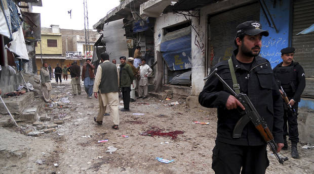 Pakistani police commandos cordon off an area after a blast in Hangu, Pakistan on Friday, Feb 1, 2013. A suicide bomber detonated his explosives outside a Shiite mosque in northwestern Pakistan as worshippers were leaving Friday prayers, killing several people and wounding scores in the latest apparent sectarian attack in the country, police said. (AP Photo/Abdul Basit)