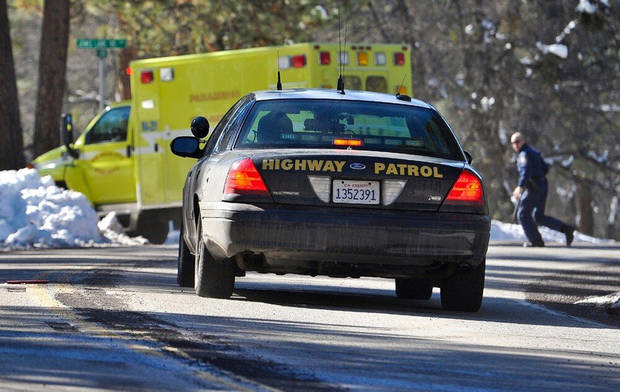 Law enforcement officials respond after Christopher Dorner, the fugitive ex-Los Angeles cop sought in three killings, engaged in a shootout with authorities that wounded two officers in the San Bernardino Mountains near Big Bear Lake, Calif., Tuesday, Feb. 12, 2013. (AP Photo/The Sun, Rachel Luna) VENTURA COUNTY STAR OUT; RIVERSIDE PRESS-ENTERPRISE OUT; THE VICTOR VALLEY DAILY PRESS OUT
