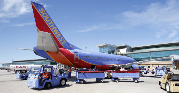 Workers unload a Southwest Airlines flight at Will Rogers World Airport in Oklahoma City, September 27 , 2010. Photo by Steve Gooch, The Oklahoman