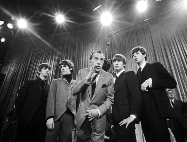 "In this Feb. 9, 1964 file photo, Ed Sullivan, center, stands with The Beatles, from left, Ringo Starr, George Harrison, John Lennon, and Paul McCartney, during a rehearsal for the British group's first American appearance, on the ""Ed Sullivan Show,"" in New York. CBS is planning a two-hour special on Feb. 9, 2014, to mark the 50th anniversary of the Beatles' first appearance in America on ""The Ed Sullivan Show."" (AP)"