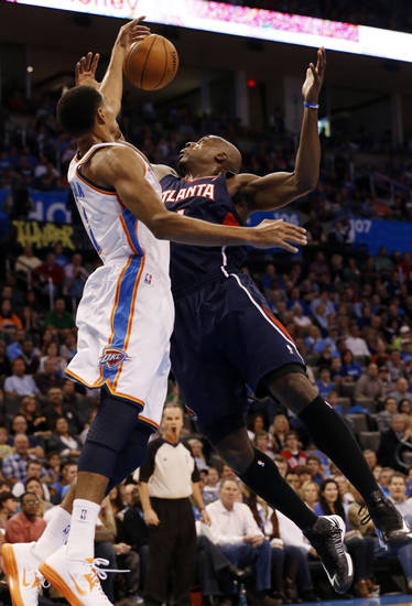 Oklahoma City Thunder's Thabo Sefolosha (2) bats the ball away from Atlanta Hawk's Anthony Tolliver (4) as the Oklahoma City Thunder play the Atlanta Hawks in NBA basketball at the Chesapeake Energy Arena in Oklahoma City, on Sunday, Nov. 4, 2012.  Photo by Steve Sisney, The Oklahoman