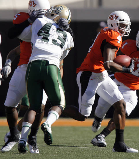 Oklahoma State's Justin Gilbert (4) returns a kick for a touchdown during the college football game between the Oklahoma State University Cowboys (OSU) and the Baylor University Bears at Boone Pickens Stadium in Stillwater, Okla., Saturday, Nov. 6, 2010. Photo by Chris Landsberger, The Oklahoman