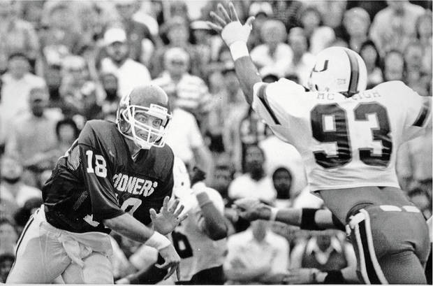 Troy Aikman had to face a tough Miami defense back in 1985 and suffered a broken leg in the second quarter of OU's loss. Jamelle Holieway went on to help lead the Sooners to the national title. Aikman eventually wound up at UCLA. OKLAHOMAN ARCHIVE   ORG XMIT: 0709032153572662