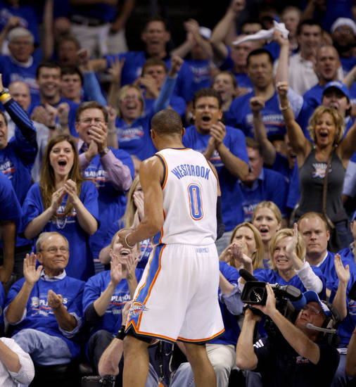 Oklahoma City's Russell Westbrook (0) celebrates in front of the crowd during the NBA basketball game between the Denver Nuggets and the Oklahoma City Thunder in the first round of the NBA playoffs at the Oklahoma City Arena, Sunday, April 17, 2011. Photo by Bryan Terry, The Oklahoman