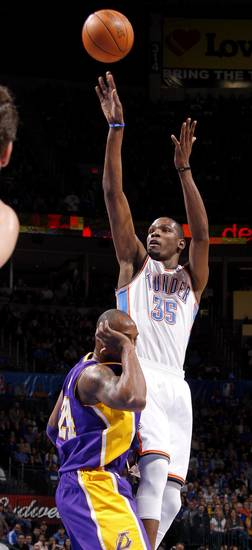 Oklahoma City's Kevin Durant (35) shoots the ball behind Los Angeles' Kobe Bryant (24) during an NBA basketball game between the Oklahoma City Thunder and the Los Angeles Lakers at Chesapeake Energy Arena in Oklahoma City, Thursday, Feb. 23, 2012. Photo by Bryan Terry, The Oklahoman