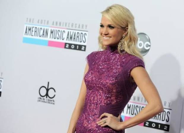 Carrie Underwood arrives at the 40th Anniversary American Music Awards on Sunday, Nov. 18, 2012, in Los Angeles. (AP)