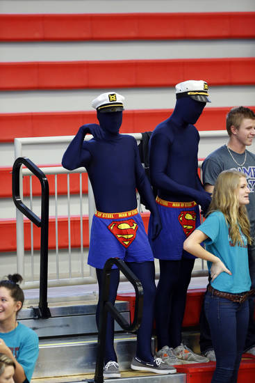 Shawnee fans Austin Cooper and Luke Laster wear Blue Men outfits as their team plays Booker T. Washington during the Class 5A State Championship volleyball tournament on Friday, Oct. 12, 2012, in Moore, Okla.  Photo by Steve Sisney, The Oklahoman