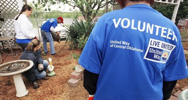 Volunteers do landscape work at the Oklahoma Foundation for the Disabled during the Day of Caring.