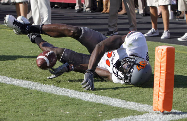 Oklahoma State's Justin Blackmon tries to save his fumble from going out of bounds in the end zone in the second half. Blackmon had a clear path to the end zone, but lost control of the ball, which bounded out of the end zone. Texas A&M took over at their own 20-yard line but promptly threw an interception, capping one of the crazier series of plays in the game. Photo by Sarah Phipps, The Oklahoman