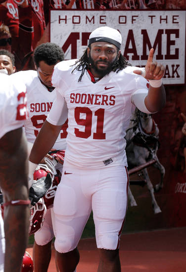 Charles Tapper (91) steps onto the filed before the annual Spring Football Game at Gaylord Family-Oklahoma Memorial Stadium in Norman, Okla., on Saturday, April 13, 2013. Photo by Steve Sisney, The Oklahoman