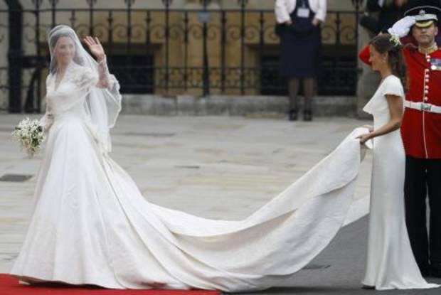 Kate Middleton arrives at Westminster Abbey. Her sister Pippa holds the train. AP PHOTO