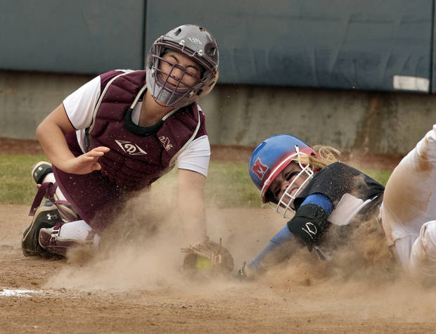 Jenks catcher Audrey Estes tries to tag Moore's Hannah Lynch at home during the 2012 State Fast-Pitch Softball Tournament on Thursday, Oct. 11, 2012 at ASA Hall of Stadium in Oklahoma City, Okla.  Lynch was safe.  Photo by Steve Sisney, The Oklahoman