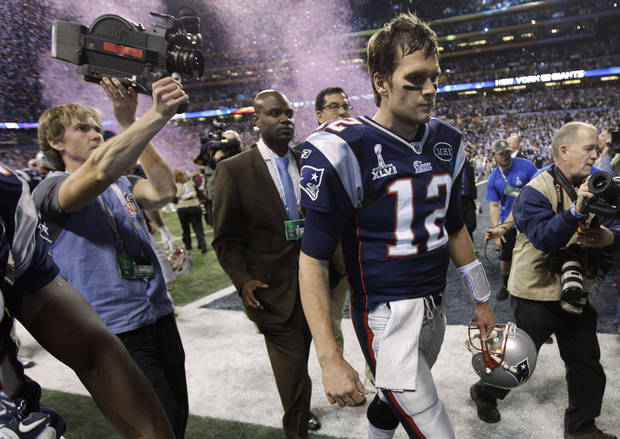 New England Patriots quarterback Tom Brady walks off the field after the Patriots' 21-17 loss to the New York Giants in the NFL Super Bowl XLVI football game, Sunday, Feb. 5, 2012, in Indianapolis. (AP Photo/Paul Sancya) ORG XMIT: SB486