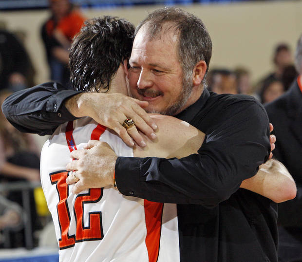 STATE TOURNAMENT: Cheyenne-Reydon coach Brad Thrash hugs son Austin Thrash (12) after the Class A boys state championship high school basketball game between Cheyenne-Reydon and Merritt at State Fair Arena in Oklahoma City, Saturday, March 3, 2012. Cheyenne-Reydon won, 51-30. Photo by Nate Billings, The Oklahoman
