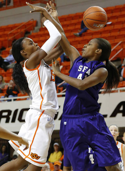 Oklahoma State's Toni Young (15) runs into Stephen F. Austin's Wykeia Sanders (41) during a women's college basketball game between Oklahoma State University and Stephen F. Austin at Gallagher-Iba Arena in Stillwater, Okla., Thursday, Dec. 6, 2012.  Photo by Bryan Terry, The Oklahoman