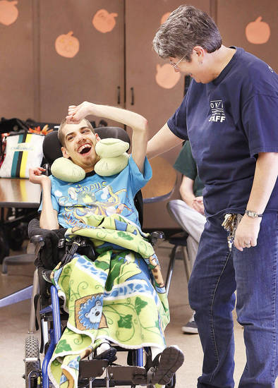 Client Joshua Cartwright and staff member Mary Haddad at the Oklahoma Foundation for the Disabled.    Photo by Jim Beckel, The Oklahoman <strong>Jim Beckel - THE OKLAHOMAN</strong>