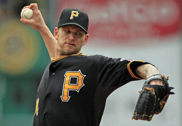 Pittsburgh Pirates starter A.J. Burnett delivers a pitch during the first inning of a baseball game against the Atlanta Braves in Pittsburgh, Wednesday, Oct. 3, 2012. (AP Photo/Gene J. Puskar)