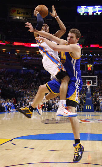 Oklahoma City's Russell Westbrook (0) runs into Golden State's David Lee (10) during the NBA basketball game between the Oklahoma City Thunder and the Golden State Warriors at the Oklahoma City Arena, Tuesday, March 29, 2011. Photo by Bryan Terry, The Oklahoman