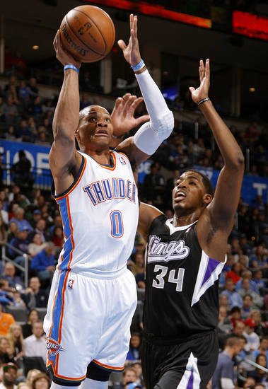 Oklahoma City's Russell Westbrook (0) goes past Sacramento's Jason Thompson (34) during an NBA basketball game between the Oklahoma City Thunder and the Sacramento Kings at Chesapeake Energy Arena in Oklahoma City, Friday, Dec. 14, 2012. Photo by Bryan Terry, The Oklahoman