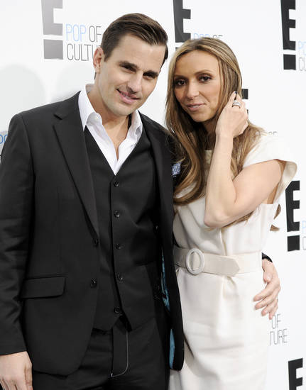 FILE - This April 30, 2012 file photo shows Bill Rancic, left, and his wife Giuliana Rancic attending an E! Network upfront event at Gotham Hall in New York. The couple have welcomed son Edward Duke to their family.  Edward was born in Denver via a gestational surrogate on Wednesday, Aug. 29. He weighed 7 pounds and 4 ounces. The couple was in the delivery room for the four-hour labor and birth. Giuliana Rancic is a red-carpet fixture and host of E! News, and Bill is an entrepreneur and motivational speaker, who was the first-season winner on TV's �The Apprentice.�  Together, they star in a Style Network reality show called �Giuliana & Bill� that dealt with their fertility issues. (AP Photo/Evan Agostini, file)