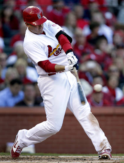 St. Louis Cardinals' Allen Craig hits a solo home run during the third inning in Game 2 of baseball's National League division series against the Washington Nationals, Monday, Oct. 8, 2012, in St. Louis. (AP Photo/Tom Gannam)