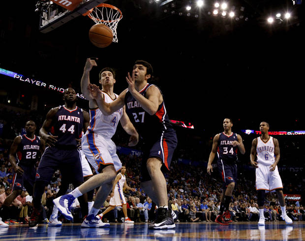 Oklahoma City Thunder's Nick Collison (4) and Atlanta Hawk's Zaza Pachulia (27) fight for a rebound as the Oklahoma City Thunder play the Atlanta Hawks in NBA basketball at the Chesapeake Energy Arena in Oklahoma City, on Sunday, Nov. 4, 2012.  Photo by Steve Sisney, The Oklahoman