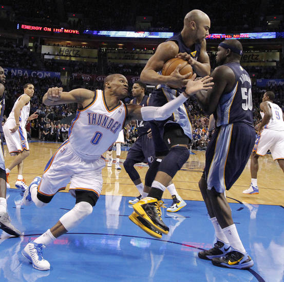 Oklahoma City's Russell Westbrook (0) goes after the ball against Memphis' Jerryd Bayless (7) during the NBA basketball game between the Oklahoma City Thunder and the Memphis Grizzlies at Chesapeake Energy Arena on Wednesday, Nov. 14, 2012, in Oklahoma City, Okla.   Photo by Chris Landsberger, The Oklahoman