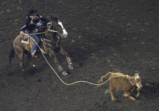 Matt Shiozawa, of Chubbuck, Idaho, competes in tie-down roping during the Ram National Circuit Finals Rodeo Championship in Oklahoma City, Sunday, April 1, 2012.  Photo by Garett Fisbeck, For The Oklahoman