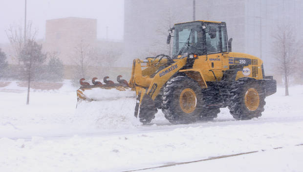 A loader tries to clear snow in near whiteout conditions along the NW Expressway and access roads around Integris Baptist Medical Center in Oklahoma City Tuesday, Feb. 1, 2011.   Photo by Paul B. Southerland, The Oklahoman