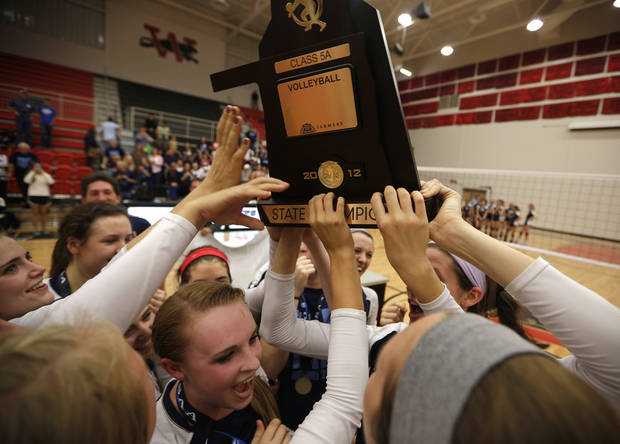 Cascia Hall holds up their trophy after winning the OSSAA 5A State Volleyball Championship between Cascia Hall and Heritage Hall at Westmoore High School in Moore, Okla., Saturday, Oct. 13, 2012.  Photo by Garett Fisbeck, The Oklahoman