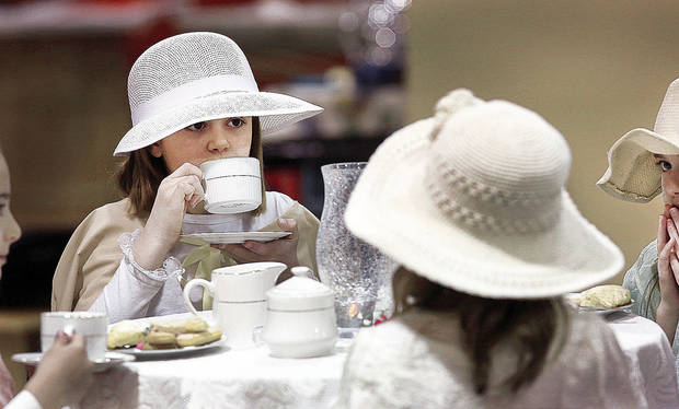 Alice Hobbs, 9, sips tea during the Victorian tea.