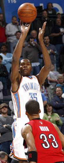 Oklahoma City's Kevin Durant shoots over Jamario Moon of Toronto in the first half during the NBA basketball game between the Toronto Raptors and the Oklahoma City Thunder at the Ford Center in Oklahoma City, Friday, Dec. 19, 2008. BY NATE BILLINGS, THE OKLAHOMAN