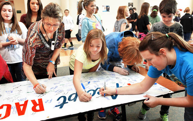 Cheyenne Middle School students and faculty sign the Rachel�s Challenge banner. Photo by Jim Beckel, The Oklahoman