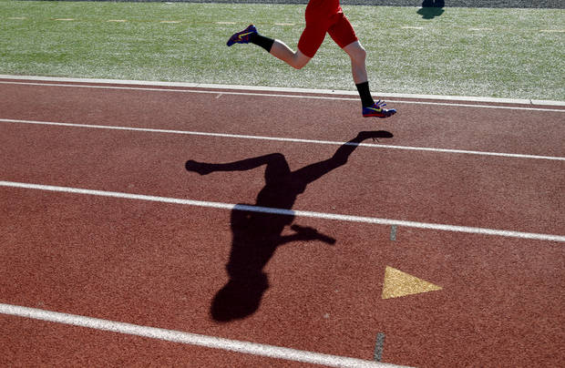 A runner competes in a 3,200 meter-relay during the Meet of Champions at Yukon High School on Tuesday, May 14, 2013. Photo by Bryan Terry, The Oklahoman