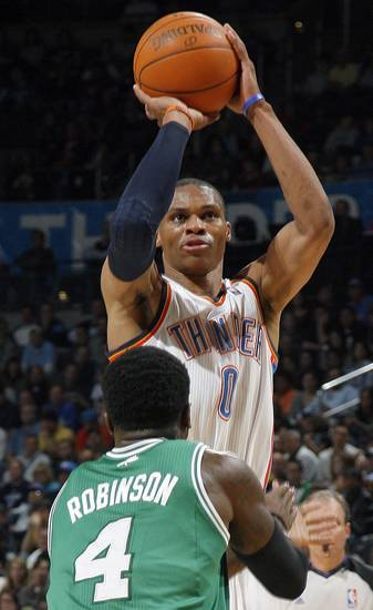 Oklahoma City's Russell Westbrook (0) shoots over Boston's Nate Robinson  (4) during the NBA game between the Oklahoma City Thunder and the Boston Celtics, Sunday, Nov. 7, 2010, at the Oklahoma City Arena. Photo by Sarah Phipps, The Oklahoman