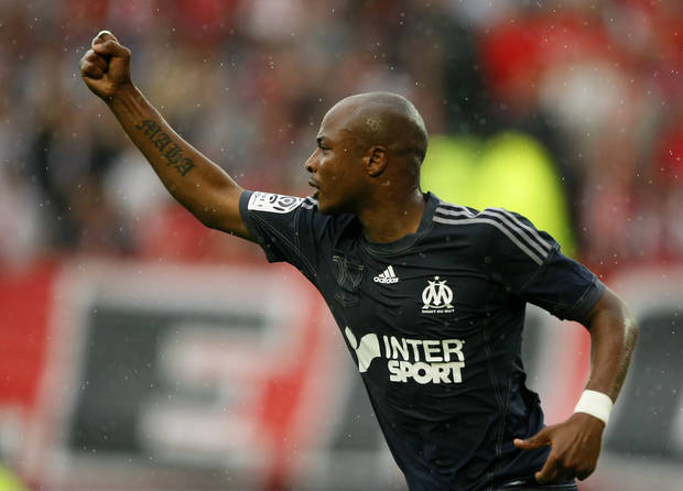 Marseille's forward Andre Ayew celebrates after scoring a goal for his team during their French League one soccer match against Valenciennes, in Valenciennes, northern France, Saturday, Aug. 24, 2013. (AP Photo/Michel Spingler)