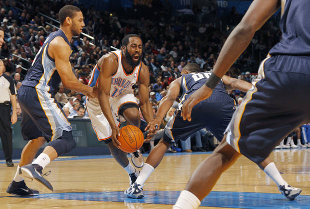 James Harden (13) is fouled by Memphis' Darrell Arthur (00) and Xavier Henry (13) during the NBA basketball game between the Oklahoma City Thunder and the Memphis Grizzlies at the Oklahoma City Arena on Tuesday, Feb. 8, 2011, Oklahoma City, Okla.  Photo by Chris Landsberger, The Oklahoman