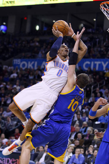 NBA BASKETBALL/NBA/OKLAHOMA CITY THUNDER/GOLDEN STATE WARRIORS Oklahoma City's Russell Westbrook drives into Golden State's David Lee during the Thunder - Warriors game Sunday, December 5, 2010 at the Oklahoma City Arena. Photo by Hugh Scott, The Oklahoman ORG XMIT: KOD
