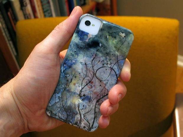 "This is an iPhone case featuring the art of Tribalbot. ""Bloomign Currents"" is title of the painting featured on this case. Photo provided. <strong></strong>"